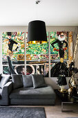 Triptych above grey sofa in glamorous living room
