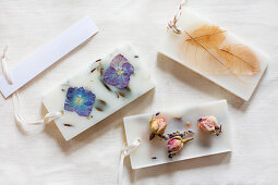 Flowers and leaves in blocks of wax