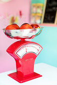 Fruit on red kitchen scales