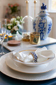 Elegant gold-rimmed china on classically set table