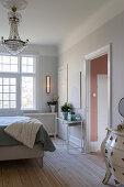 Elegant bedroom in pale grey