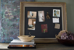 Old picture frame repurposed as pin board