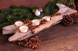 Driftwood candle holder decorated for Christmas