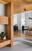 Steps to the higher living level with dining room in the architect's house
