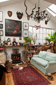 Eclectic living room decorated with curiosities in former factory sales area