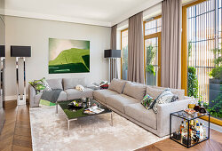 Grey sofa set, coffee table and minibar in elegant living room