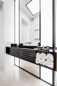 Floating washstand and marble floor in elegant bathroom