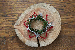 Rustic star made from nails and felt yarn and wreath on wooden board