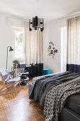 Parquet flooring in bright Japandi-style bedroom