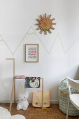 Mountain chain drawn on wall with washi tape in child's bedroom