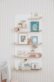 Curved wooden shelf for books and pictures in children's rooms