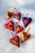 Colourful, handmade, heart-shaped, felt Christmas tree decorations