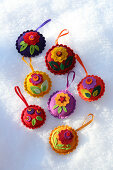 Colourful, handmade, felt Christmas tree decorations