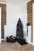 Cast iron stove in corner of rustic room