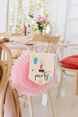 Pink paper rosette and paper party pendant