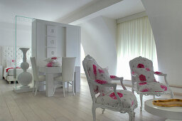 Luxurious, white guest room with pink accents