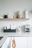 Kitchen utensils on shelves in minimalist, modern kitchen