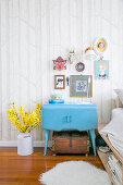 Pale blue vintage cabinet next to bed in bedroom