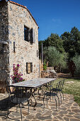 Table and chairs on terrace of Italian stone house