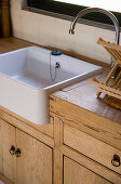 Kitchen counter with wooden doors and sink