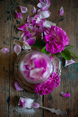 Pink roses and sugar in screw-top jar