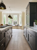 Island counter in elegant kitchen with bay window