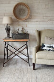 Rustic ornaments on side table next to armchair