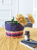Storage basket made from knitted tubes made using knitting dolly