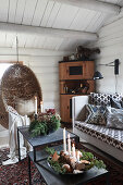 Hanging chair in rustic living room of log cabin