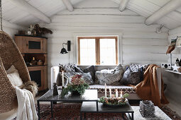Cosy winter ambience in rustic living room of log cabin