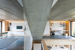 Modern, open-plan interior with net, concrete and plywood elements