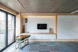 Old school desk in living room of modern architect-designed housee