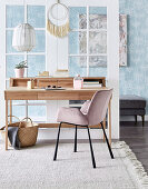 Desk with upholstered chair in front of glass door