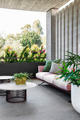 Sofa, coffee table and plants on the covered terrace