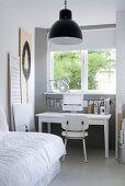 Desk below window in grey-and-white bedroom