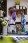 Flea-market crockery and kitchen utensils in vintage outdoor kitchen