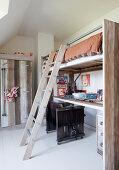 Desk below loft bed in child's bedroom with Wild West theme