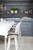 Dining area and outdoor kitchen in grey on terrace