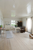 Scandinavian-style dining room with ceiling panelling and floorboards