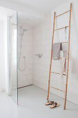 Bamboo towel rail next to shower area in bathroom