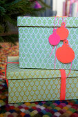 Homemade gift tags in the shape of a Christmas tree ornament made of paper