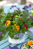 Bouquet of parsley, sage, mint, rosemary and French marigolds