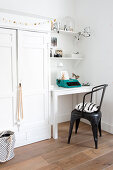 Festively decorated white cupboard next to small desk and chair