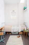 Metal bed and vintage-style accessories in child's bedroom