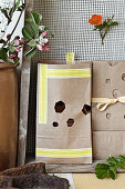 Homemade gift bags made of wrapping paper with cut out honeycomb shapes