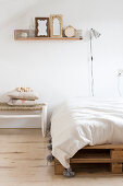 Pallet bed under the picture rail in the simple bedroom
