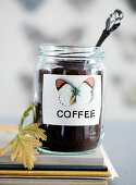 Screw-top jar as a coffee canister with a butterfly motif