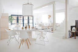 Round table with classic chairs in a white, open living room
