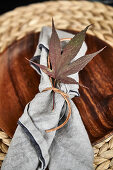 Place setting decorated with autumn leaves