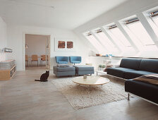 Modern living room with skylights and view into the dining area
